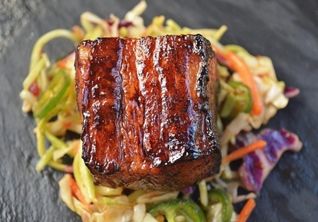 Slow Roasted Pork Belly Bites over Jalapeno Slaw