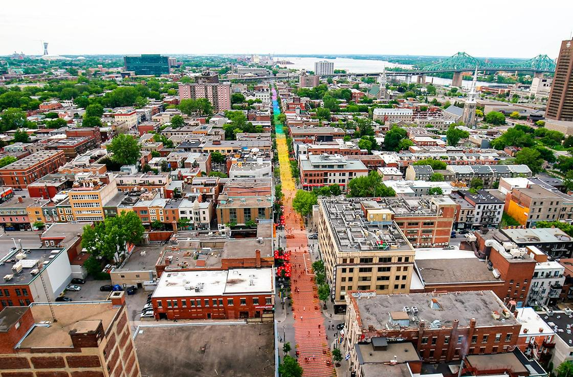 A 1-kilometer-long rainbow suspended over a street in Montreal