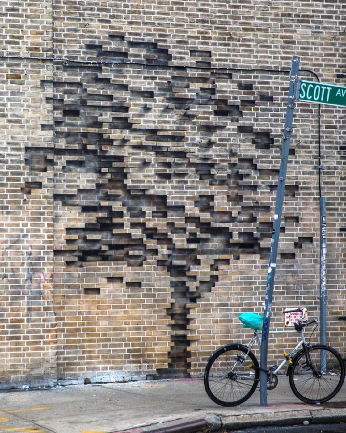 Pejac unveils two stunning optical illusions in the streets of New York